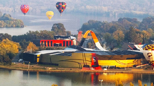 Hot air balloons over National Museum of Australia